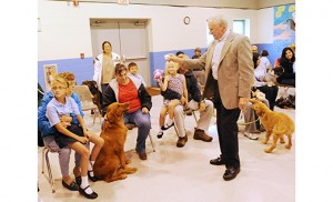 Deacon Richard Maxwell blesses pets at St. Vincent de Paul Regional School, Mays Landing, on Oct. 2. The school had a blessing of pets in honor of St. Francis of Assisi, patron of animals, whose feast day is Oct. 4. Photo by Alan M. Dumoff, more photos ccdphotolibrary.smugmug.com