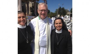 "Father Vince Guest, pastor of Holy Cross Parish, Bridgeton, is pictured with Sister Maria de Jesus and Sister Graciela at The Catholic University of America for the papal Mass and canonization of St. Junipero Serra. When leaving the United States, Pope Francis called American nuns ""great, great, great women."""