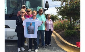 A group poses in front of their bus on the way to Washington, D.C. to see Pope Francis' address to the Joint Session of Congress on Sept. 24.