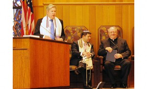 On Oct. 16, Bishop Dennis Sullivan celebrated a Shabbat service with Jewish leaders at Temple Emanuel in Cherry Hill. During the evening, he outlined his new initiative for Catholic schools in the Diocese of Camden for better teaching of Holocaust education with speakers, materials and programs offered through the Jewish Community Relations Council of South Jersey's Goodwin Holocaust Museum and Education Center. Father Joseph Wallace, diocesan director of Ecumenical and Inter-Religious Affairs, accompanied Bishop Sullivan to the gathering.  Above, Bishop and Assistant Rabbi Lawrence R. Sernovitz listen as Senior Rabbi Jerome David addresses the gathered. Photo by Alan M. Dumoff