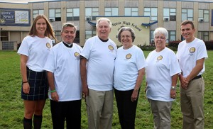 """In celebration of Pope Francis' visit to the United States and the launch of Holy Spirit's commitment to join Pope Francis in bringing his message of love and mercy to life, members of the Absecon high school recently gathered for a """"photo with Pope Francis (cut-out)."""" Custom designed T-shirts were given to each student after they signed a promise to provide acts of service and kindness consistent with Pope Francis' message. Pictured at top: Erin Shober '17 of Absecon, Father Perry Cherubini, school president, Mr. and Mrs. Robert Dye of St. Elizabeth Ann Seton Parish, Susan Dennen, principal, and Matthew Nyce '16 of Smithville. The T-shirts were made possible through the generosity of Mr. and Mrs. Robert Dye."""