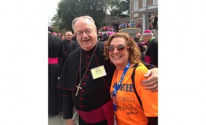 Bishop Dennis Sullivan is pictured at Independence Hall, Philadelphia, with Karen Mallamaci, parishioner of Christ Our Light, Cherry Hill who volunteered for WMOF with her husband, Anthony. Bottom: Kate Deutsch, a student at Camden Catholic High School, Cherry Hill, and her mother, Nancy Falvey Deutsch, attend the papal Mass on Sept 27; Tim and Shireen Dastis of Blackwood, and Dan Moore of Washington Township wore homemade miters to the city on Sept. 26. Bottom photos by Carl Peters