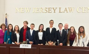 Pictured are the Holy Spirit High School defense team and coaches. From left, Mary Beth Clark, attorney coach, Law Firm of Levine, Staller, Sklar, Chan & Brown; students Kara O'Brien, Courtney Randik, Jack Bannan, Chris Gross, Nicole Wenzel, Olivia Torres and Steven Grimmie; David Pfeifer, faculty advisor; and students: Maggie Gibbons and Cierra Grabill.