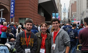 Matt and Sue Kresich, and Scott Peters, pictured on Broad Street in Philadelphia where they watched the Sept, 27 papal Mass on a Jumbotron, were among a group of pilgrims who came from Gary, Indiana, to see the pope. Catholic Charities, Diocese of Camden, and local parishes provided hospitality. Photo by Carl Peters