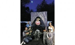 Sleeping Beauty and her Prince Charming, along with Maleficent and her dragon put on a good show at the St. Mary School Trunk or Treat held in Williamstown on Oct. 23. Shown from left are Justin Dickey, Michael Hensh, Cameron Dickey (1), Erin Hensh, Olivia Hensh (5), and Allison Dickey.