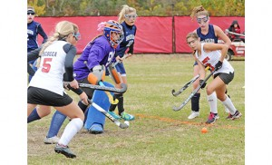 In high school field hockey, Saint Joseph (Hammonton) defeated visiting Holy Spirit (Absecon) 3-0 on Oct. 27. Above, Holy Spirit goalie Rachel Migone blocks the shot of Carlina Sacco (2). Photo by Alan M. Dumoff