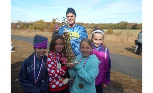 The St. Rose of Lima School, Haddon Heights, girls cross country team finished first in their division. Pictured are Coach Tony Walter, and members of the girls team: Ashley Batejan, Gianna Cicco, Shaelen McNally, and Mia McNally.