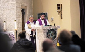 Father Hugh Bradley and Msgr. Joseph DiMauro prepare to speak in front of the faithful at Mary, Mother of Mercy Parish in Glassboro on Dec. 16. They and other diocesan priests led an Advent Penance Service, as did other diocesan churches from Dec. 15-17. Photo by Mike Walsh