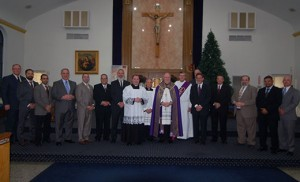 On Dec. 15 at Our Lady of Peace Parish's Saint Mary Church in Williamstown, Bishop Dennis Sullivan celebrated Evening Prayer and the Call to Candidacy for Holy Orders to the Permanent Diaconate, with 13 men. With Bishop Sullivan; Father James Bartoloma, chancellor; Father Cadmus Mazzarella, pastor; and Deacon Michael Carter, director of Formation for the Permanent Diaconate, are the new deacon candidates Philip Curran, from Church of the Holy Family, Sewell; Charles Dillin, Our Lady of Peace; Robert Dooley, Jr., Our Lady of the Angels, Cape May Court House; Tobias Haley, Saints Peter and Paul, Turnersville; Oscar Hernandez, Our Lady of Guadalupe, Lindenwold; Joseph Janocha, Our Lady of Peace; Dean Johnson, Mary, Mother of Mercy, Glassboro; George Paladino, Our Lady of the Blessed Sacrament, Newfield; Edwin Santos, Holy Eucharist, Cherry Hill; Charles Schiapelli, Christ the Good Shepherd, Vineland; Samuel Spoto, Saint Claire of Assisi, Gibbstown; Michael Vitarelli, Christ the Redeemer, Atco; and James Willis, Saint Gabriel the Archangel, Carneys Point. Photo by James A. McBride
