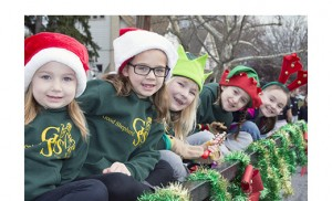 Good Shepherd Regional School students ride on a flatbed as they participate in the Collingswood Holiday Parade.