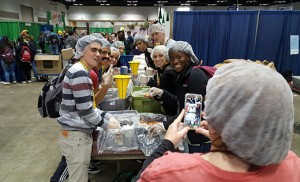 Youth make meals for the hungry.
