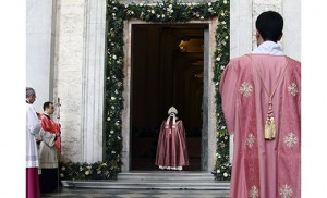 Pope Francis walks through the Holy Door at the Basilica of St. John Lateran in Rome Dec. 13. Holy doors around the world were opened at city cathedrals, major churches and sanctuaries Dec. 13 as part of the Jubilee of Mercy. (CNS photo/Evandro Inetti)