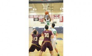 On Dec. 30, Camden Catholic, Cherry Hill, bested Gloucester Catholic, 52-39, in a high school mens' basketball Holiday Showcase game at Eastern High School in Voorhees. Above, Camden Catholic's Baba Ajike goes up for a shot. Photo by Alan M. Dumoff