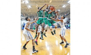 On Jan. 21, the Paul VI Eagles defeated the visiting Camden Catholic Irish in Haddon Township, by a score of 51-38. Above, the Irish's Chris Okafor, Jamal Parker and Terrance Harris jump as a team for control of the ball. Photo by Alan M. Dumoff, more photos http://ccdphotolibrary.smugmug.com