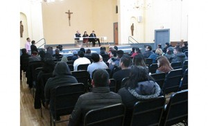 Immigration lawyer Derek DeCosmo, left, addresses an auditorium full of people interested in knowing about how new immigration enforcement priorities will affect them. The forum was held at St. Joseph Pro-Cathedral School, Camden. Photo by Joanna Gardner