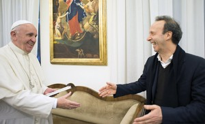 """CNS photo/L'Osservatore Romano, handout Pope Francis greets Italian actor Roberto Benigni during a meeting with people involved in the publishing of """"The Name of God Is Mercy"""" at the Domus Sanctae Marthae at the Vatican Jan. 11. The book features an interview the pope did with Italian journalist Andrea Tornielli."""