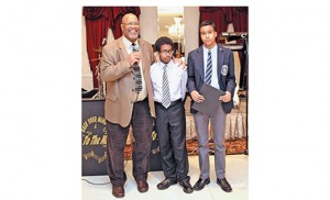 Ricardo Taylor, scholarship chairperson, congratulates Stephen Malloy and Myles Holder, winners of the annual Black Catholic Ministry Commission scholarships. The presentation was made during the commission's annual Afternoon of Jazz, Plus on Feb. 14 at Masso's Crystal Manor, Glassboro. Photo by Alan M. Dumoff