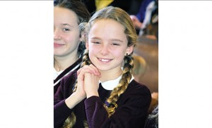 Grace Malcarney, a fifth grade student at Christ the King School, Haddonfield, attends Mass  to begin Catholic Schools Week Jan. 31 at Christ the King Church. Bishop Dennis Sullivan was the celebrant. Photo by Cynthia Soper
