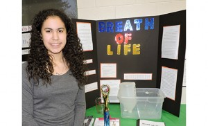 "Rosemarie Beyers, an eighth grader from Mays Landing, stands by her project, ""Breath of Life,"" at the Saint Vincent de Paul School science fair."