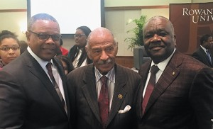 Curtis H. Johnson, left, and James E. Andrews, right, stand with Rep. John James Conyers, Jr. at a Black History Month program. Conyers was the keynote speaker.