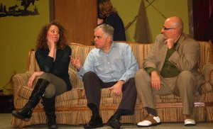"""Gil Scutti (Uncle George) sits between couple Stephanie Smaldore (Gloria Shumway) and Anthony Ciro (Andrew Shumway), with Abigail Hasson (Joanne Bryant) behind them, during rehearsal for the play """"The Money in Uncle George's Suitcase"""" last Monday night at Mater Ecclesiae, Berlin. Photo by Peter G. Sánchez"""