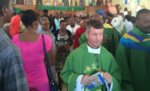 Father Joseph D. Wallace, pastor of Notre Dame de la Mer Parish, at the end of Mass in Haiti.