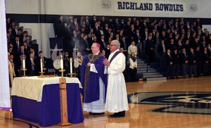 Bishop Dennis Sullivan celebrates Mass with Father Donald F. Reilly, OSA, president of Saint Augustine Preparatory School, Richland, during a Feb. 24 visit to the school.