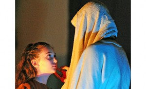"Jesus, portrayed by Gabriel Arasim, comforts the daughter of Jairus (Gianna Delcampo) during a presentation of ""Jesus the Healer: A Living Meditation on Healing"" by the Franciscan Mystery Players at Our Lady of Perpetual Help Parish, Saint Nicholas Church, Egg Harbor, on March 4. The plays employ lighting, music, drama and reflections on suffering and healing. Sponsored by Our Lady of Hope Parish in Blackwood, and dedicated to the Year of Mercy, the Franciscan Mystery Players have presentations scheduled at Holy Child Parish, Runnemede, on Friday, March 11, 7 p.m.; Saint Stephen Parish, Pennsauken, on Friday, March 18, 7:30 p.m.; and Our Lady of Hope, Blackwood, on Saturday, March 19, 7:30 p.m. Photo by Alan M. Dumoff"