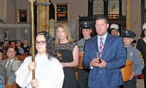 Jen and Albert Mallen, survivors of Albert J. Mallen, Sr., NJSP, bring the offertory gifts to the altar during the 31st annual memorial Mass honoring public safety personnel who died in the line of duty. Father Jon Thomas, pastor, celebrated the Mass March 13 at Saint Nicholas of Tolentine Church, Saint Monica Parish, Atlantic City. It was sponsored by the 200 Club of Atlantic and Cape May counties, a non-profit organization dedicated to providing financial support for the families of police, fire and rescue personnel who have risked and lost their lives in the line of duty. Photo by Alan M. Dumoff, more photos  ccdphotolibrary.smugmug.com