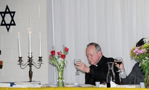 Father Mark Cavagnaro, pastor, holds up his wine glass and recites the Kiddush Prayer during a Seder at Our Lady of Hope Parish, Blackwood, on March 23. Photo by Alan M. Dumoff, more photos ccdphotolibrary.smugmug.com