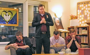 Eric Goonan, standing among fellow seminarians Patrick Erdmann, Ryan Meehan and Peter Gallagher, leads Rowan University's Catholic Campus Ministry students in a blessing on March 2 in Glassboro. The four men spoke with youth about their vocation and finding God's calling for them. Photo by Alan M. Dumoff