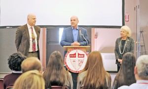 Jeff Umosella talks to students and faculty of Saint Joseph High School, Hammonton, on March 21 of his pledge of $1 million over four years to the school. Looking on are Paul Ordille of the Board of Trustees and Lynn Domenico, principal. Photo by Alan M. Dumoff