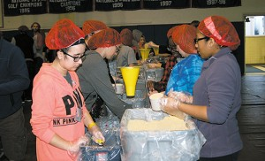 Youth prepare bags of soy flour, dehydrated vegetables and rice to go to the poor during last Sunday's Diocesan Youth Congress at Sacred Heart Center, Christ the Good Shepherd Parish in Vineland. Some 30,000 meals were packed for the needy in a day for the youth to show and know mercy. Photo by James A. McBride