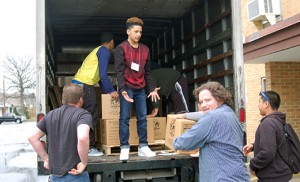 Above, youth load a truck of meals, prepared and boxed up, at the Diocesan Youth Congress in Vineland. Below, the meal-making operation. Photos by James A. McBride