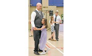"""Olivia Palumbo, grade 2, dances with her father Robert Palumbo at the Daddy-Daughter Butterfly Kisses Dance March 5 at Saint Michael the Archangel School, Clayton. Right: Grace Miedel, grade 3, dances with her father Doug Miedel. Pope Francis' postsynodal apostolic exhortation on the family, """"Amoris Laetitia"""" (""""The Joy of Love""""), is a reflection on love, family life and the importance of marriage and child-rearing. Photo by Alan M. Dumoff, more photos ccdphotolibrary.smugmug.com"""