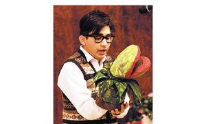 "Enzo Ronchi (Seymour) with the villainous Audrey 2, during Holy Spirit High School, Absecon's performance of ""Little Shop of Horrors"" at Seashore Gardens in Galloway Township earlier this month. The school received assistance to perform at the nursing home from the Schultz-Hill Foundation. which provides funding for organizations to entertain in locations where people might not otherwise be able to enjoy the arts."