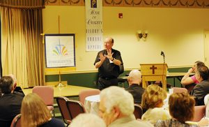 "Father John E. Hurley speaks at a workshop on New Evangelization Strategies at Saint Charles Borromeo Parish in Sicklerville on April 19. He will return to the Camden Diocese in June to speak at several parishes on the topic  ""Evangelizing Through Mercy."" Photo by Alan M. Dumoff, more photos /ccdphotolibrary.smugmug.com"