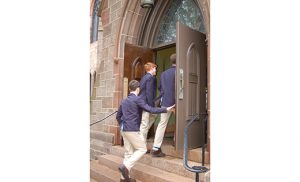 "Before their school's annual Junior Ring Mass later that night, 11th graders from Paul VI High School, Haddon Township went on pilgrimage to the Cathedral of the Immaculate Conception, Camden, entering the church's Holy Doors and greeted by Bishop Dennis Sullivan. After providing some background on the history of the diocese and the 150-year old church they were in, Bishop Sullivan reminded the students of this current Jubilee Year of Mercy. In walking through the Holy Door, they passed ""into God's grace,"" he said. He urged them to ""learn the works of mercy, and do mercy,"" in the image of the Father, ""giving your heart to others."" Photo by James A. McBride"