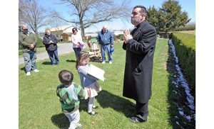 As spring weather came to the area, Father Robert Sinatra, pastor of Saint Padre Pio Parish in Vineland, blessed the farms of his church faithful during the afternoon of Sunday, April 10. He then celebrated 4:30 p.m. Mass for farmers and farmworkers at Our Lady of Pompeii Church. In photos, Father Sinatra blesses the Franchescini Farm in front of four generations of family, with help from its youngest generation. Photos by Alan M. Dumoff