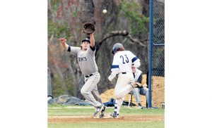 On April 27 in boys' high school baseball, the visiting Saint Augustine Prep Hermits (Richland) defeated the Holy Spirit Spartans 3-1, in Absecon.  Above, a Spartan reaches first after the Hermits' first baseman misses a high throw. Photo by Alan M. Dumoff, more photos, ccdphotolibrary.smugmug.com