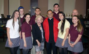 Student leaders from the 11th grade meet with Rev. Caparas: Taylor Breitzman, Marybeth McLaughlin, Maria Latshow, Michael Mascioli, Principal Lynn Domenico, Rev. Allain Camparas, JD DiRenzo, Olivia Craig, Madison Campbell, Vicar General of the Diocese Rev. Robert Hughes.