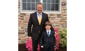 Eric Reich and his son C.J. pose for a photo on the day of C.J.'s first Communion at Saint Maximilian Kolbe Parish in Marmora. Eric received his first Communion about a month earlier.