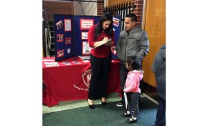 Marianela Nuñez, Field Consultant for the Latino Enrollment Initiative, speaks with a Hispanic family about Saint Michael the Archangel Regional School at Saint Bridget Parish, Glassboro. Currently, only about 3 percent of Hispanic children attend Catholic schools nationally. In the Diocese of Camden about 10 percent attend Catholic schools.