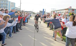 Joe Maloy, a Wildwood Catholic graduate who recently qualified for the triathlon in the Olympics this summer, arrives on a bicyle at a ceremony in his honor May 20 at Centennial Park in Wildwood Crest. Photos by Alan M. Dumoff, more photos ccdphotolibrary.smugmug.com