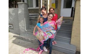 Jaclyn Marrero is pictured with her three daughters — from left, Leila, Lillyana and Aydriana — in front of their home in Camden. Photo by Joanna Gardner