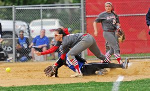 In high school girls' softball, the Saint Joseph Wildcats defeated the visiting Wildwood Catholic Crusaders 2-1 in Hammonton on May 11. Right, the Crusaders' Mia Capozzoli slides safely into third base. Photo by Alan M. Dumoff, more photos ccdphotolibrary.smugmug.com