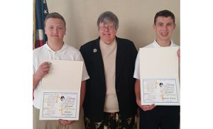 Pictured with Sister Rose DiFluri, Assistant Superintendent of Schools, are Michael Naticcione, left, eighth grade graduate from Our Lady Star of the Sea Regional School in Atlantic City, and Thomas Finan, eighth grade graduate from Assumption Regional School in Galloway. Both boys were recipients of a $1,000 tuition scholarship to Holy Spirit High School in Absecon. This is the 10th anniversary of the scholarship in memory of Dr. David T. Coghlan, superintendent of schools of the Diocese of Camden from 1994-2003. Photo by James A. McBride