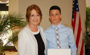 Below, Katharine Coghlan, Dr. Coghlan's wife, stands with Ethan Guldin, the third scholarship winner. Ethan is an eighth grade graduate of Gloucester Catholic Junior High and received a $1,000 scholarship to Gloucester Catholic Senior High School.