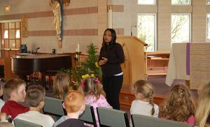"Gelina Fontaine, program manager of ChildFund Caribbean, a branch of ChildFund International, speaks to religious education students at Catholic Community of the Holy Spirit in Mullica Hill. The students wrote letters of encouragement to second and third graders on the island country of Dominica after a hurricane in 2014. The children subsequently became pen pals. Alyse Dvorak, the CCD teacher, has connections with International Center for Assault Prevention (ICAP), a program that helps people establish child protection programs in their own town or country. Among the individuals ICAP has trained is Fontaine, so when the 2016 International CAP Conference in Atlantic City was announced earlier this year, Dvorak asked if Fontaine would be interested in visiting her CCD students to talk about Dominica and the children with whom they had been corresponding. Fontaine was accompanied by Velma Moses Joseph, coordinator of East Dominica Children's Federation. ""Gelina and Velma shared their experience with the children, thanked them for all their messages of hope, and explained how it lifted the children's spirits to receive cards and letters from America,"" said Dvorak. Photo by James A. McBride"