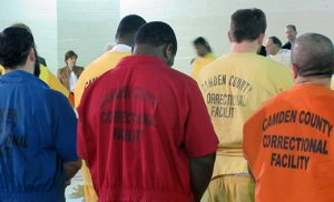 Men pray during a Mass with Bishop Dennis Sullivan at the Camden County Correctional Facility. Photo by Joanna Gardner